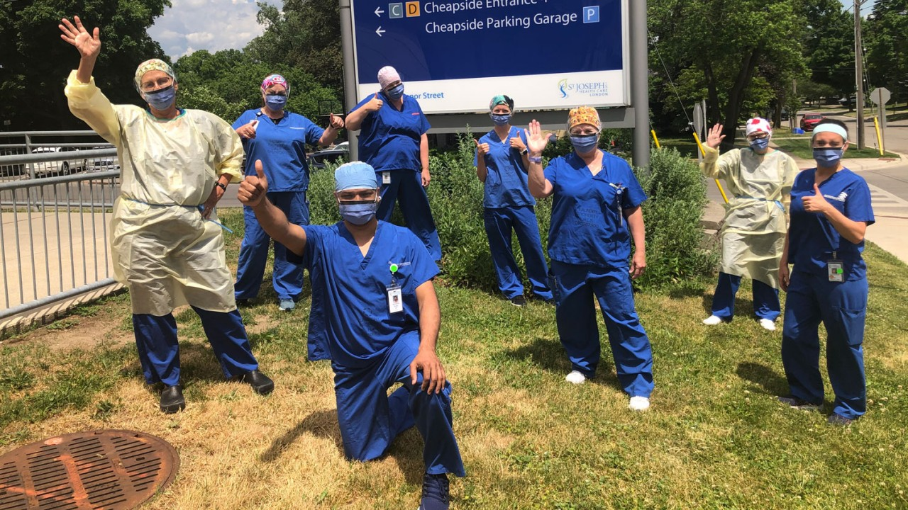 health care workers in scrubs express gratitude