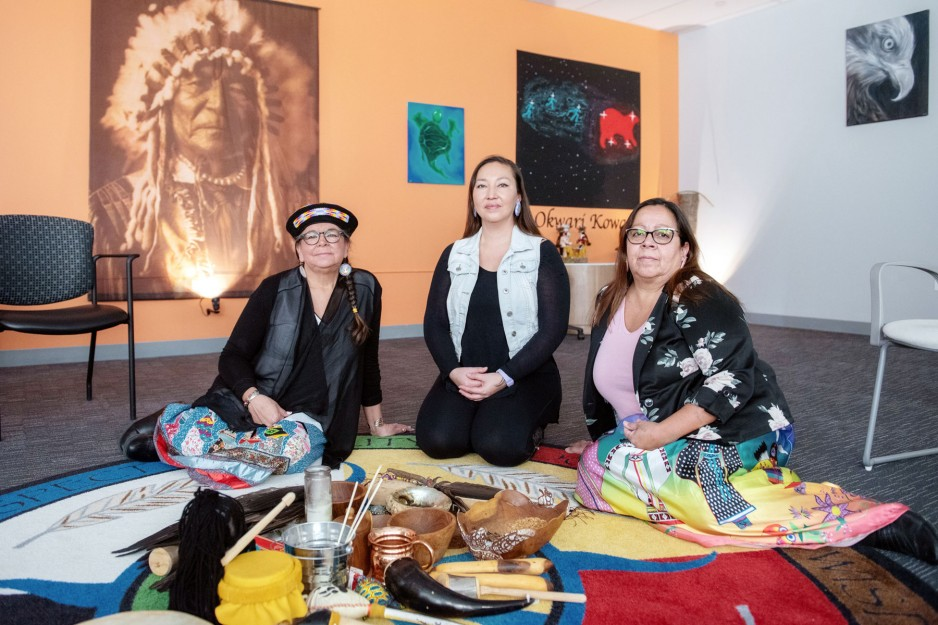Indigenous women sitting down together