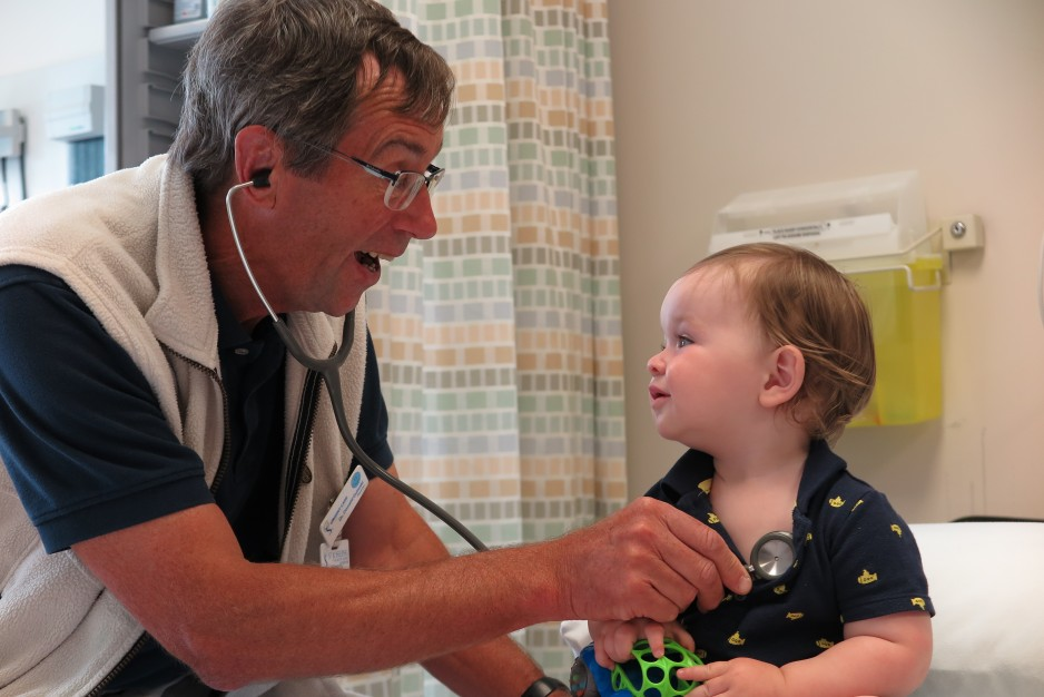 A physician treats a young child in the Urgent Care Centre.
