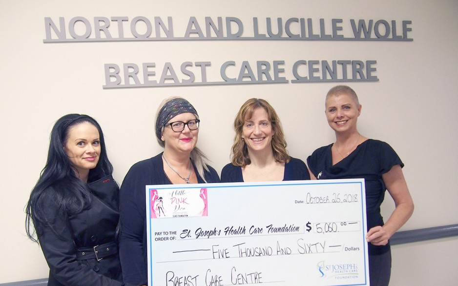 ​​Michelle Goldrick, Alanna Riley, Dr. Muriel Brackstone and Christiena Healey hold up the proceeds from A Little Pink Dress event held in October 2018.
