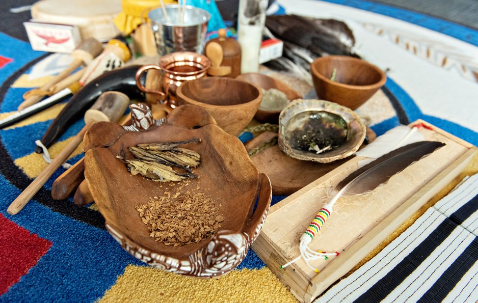 herbal medicines in shells surrounded by implements used Indigenous healing ceremonies