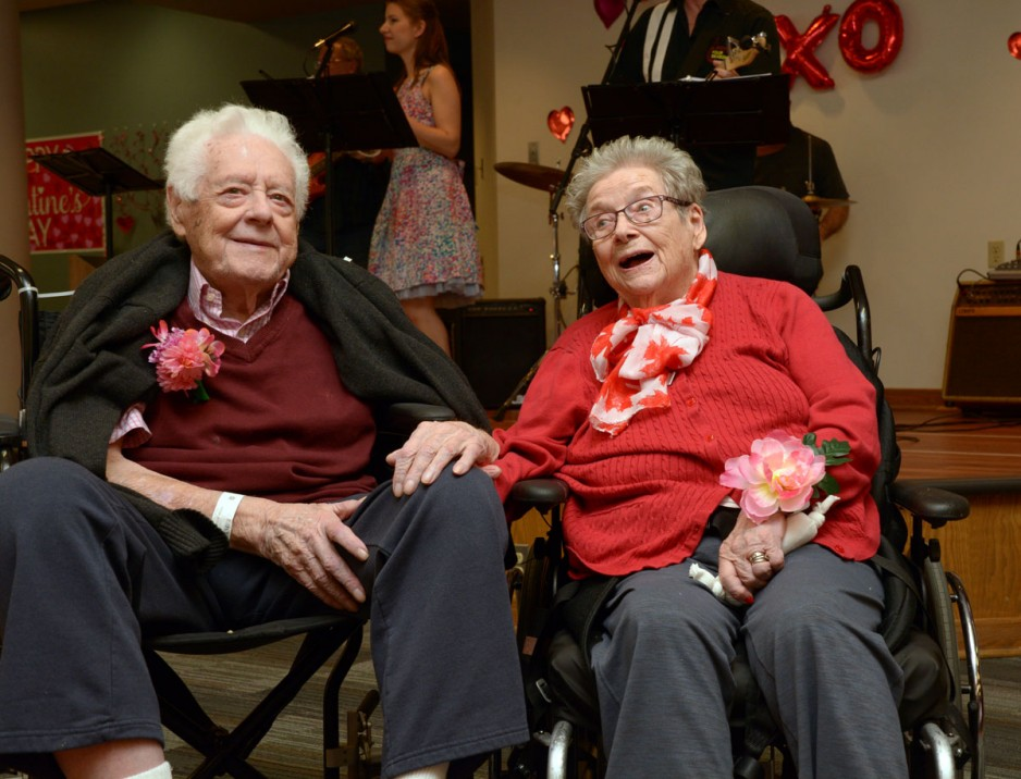 an elderly couple holding hands