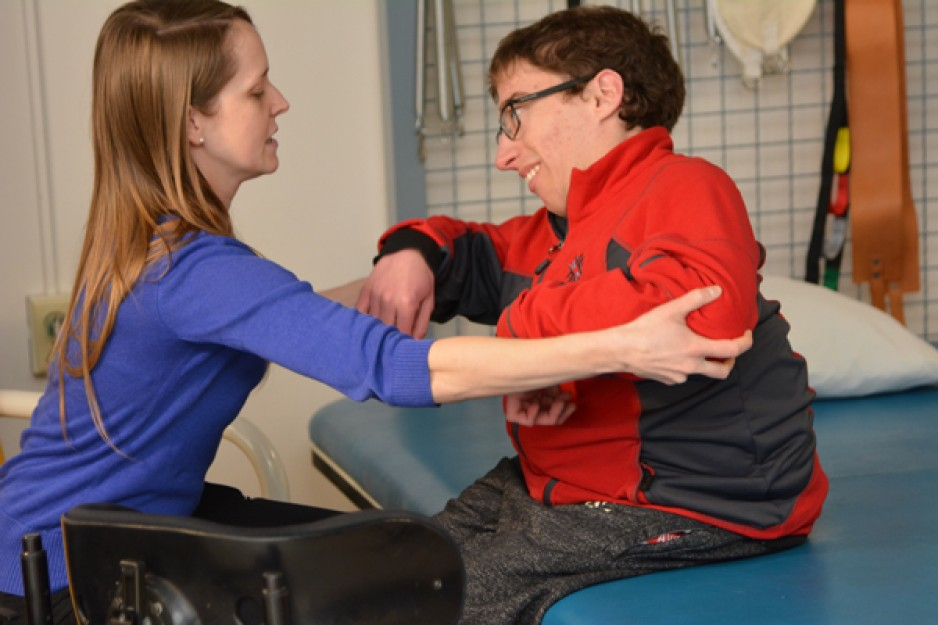 A patient and caregiver work together in the TLC program.