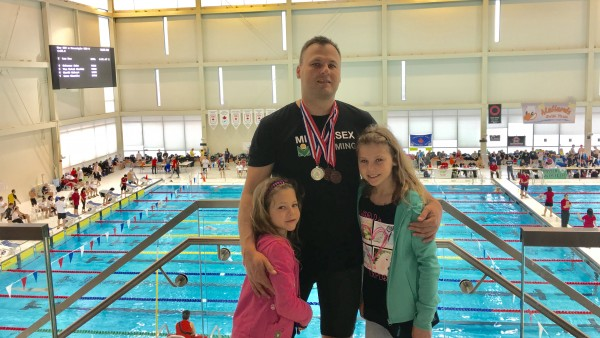 Ales Wittek celebrates his medals with his two daughters