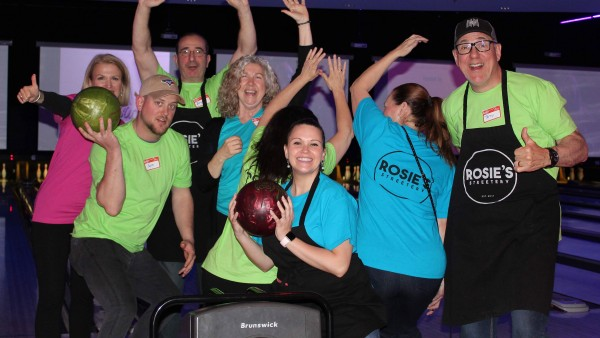 event participants at a bowling alley